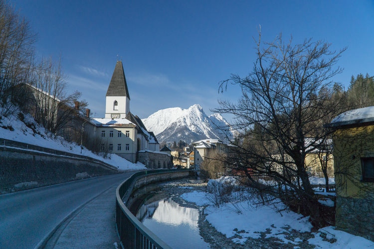 Cold Days Steiermark Austria Grundlsee Bad Aussee Winter Cold Temperature Snow Architecture Building Built Structure Nature Building Exterior Transportation Tree Place Of Worship Covering Sky Road Religion Mountain Bare Tree No People Plant Snowcapped Mountain