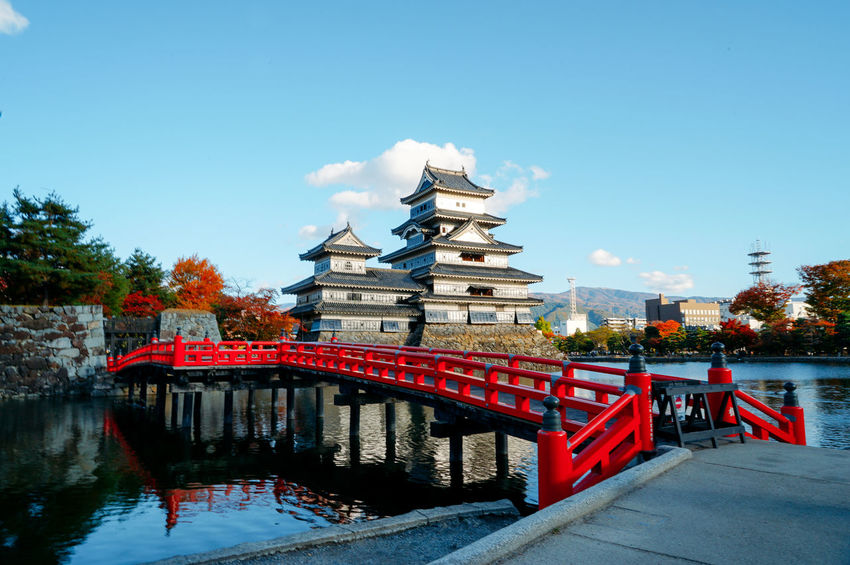 at Matsumoto Castle 松本城 Architecture Blue Bridge - Man Made Structure Built Structure Castle Colour Culture Cultures Day Engineering Fall Beauty International Landmark Japanese Castle Japanese Culture Matsumoto Castle Multi Colored No People Outdoors Red River Sky Tourism Travel Destinations Water
