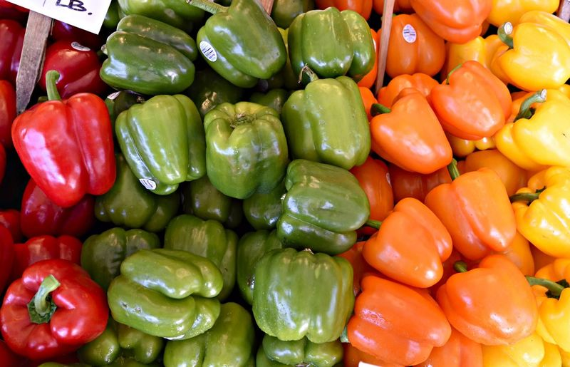 High angle view of various bell peppers at market
