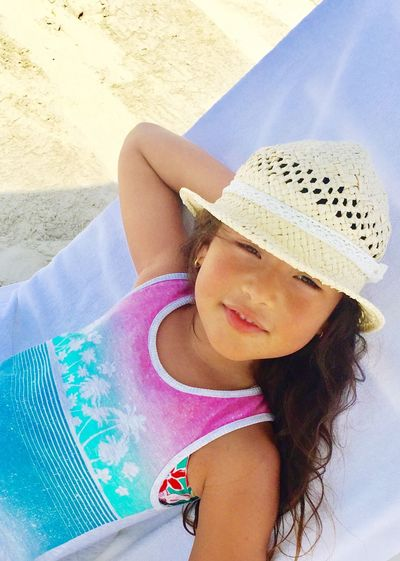 Smiling Happiness daughter Real People One Person Leisure Activity Lifestyles Day Sand Outdoors Vacations Childhood High Angle View Looking At Camera Beach Portrait Sun Hat Summer Girls Beautiful Woman Young Women