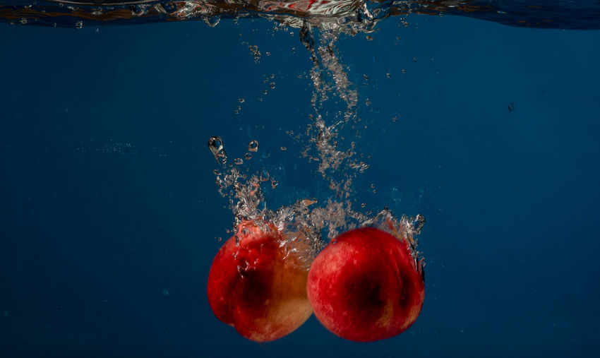 Close-Up Of Peaches In Water
