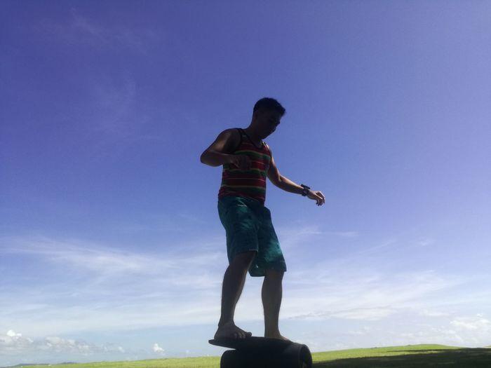 Full Length Of Man Balancing On Sports Ramp Against Blue Sky