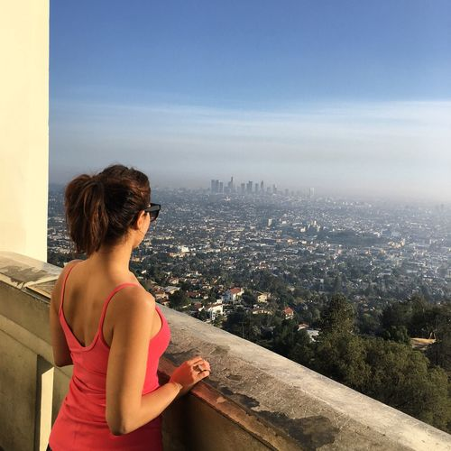 Woman Looking At City Against Sky