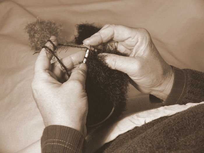 Close-Up Of Woman Knitting