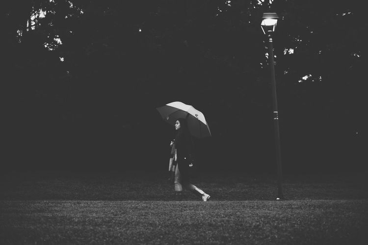 Lamp Post Black And White Full Length Holding Lifestyles Night One Person Outdoors Protection Real People Umbrella