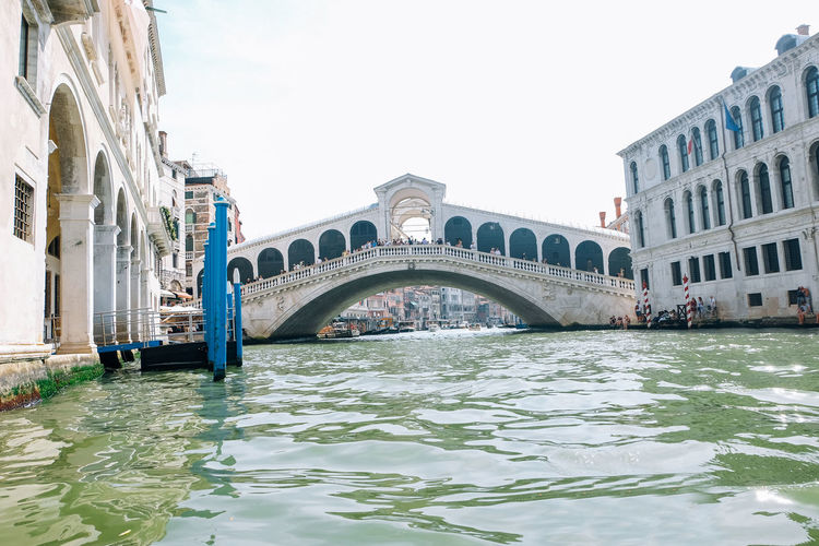 Rialto bridge in venice italy Venice Venice, Italy Italy Travel Travel Destinations Built Structure Architecture Bridge Building Exterior Water Bridge - Man Made Structure Connection Sky Waterfront Canal Nature City Arch Transportation Day Tourism Arch Bridge Outdoors Gondola - Traditional Boat Rialto Bridge