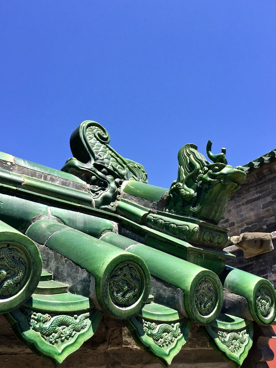 low angle view, day, blue, history, outdoors, no people, clear sky, weapon, sculpture, statue, architecture, close-up, sky