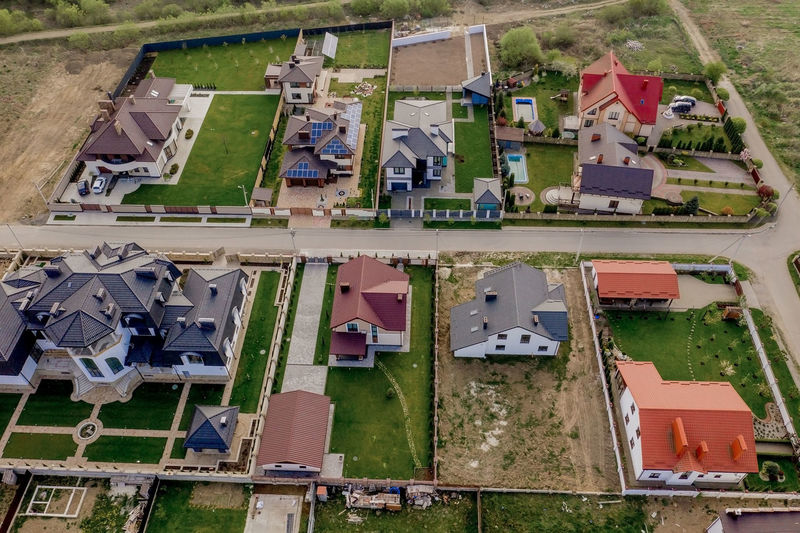 High angle view of buildings in field
