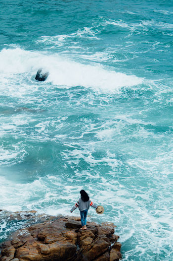 Sea Water Wave Motion Surfing Sport Aquatic Sport Real People Day People Leisure Activity Land Beach Nature High Angle View Solid Lifestyles Beauty In Nature Rock Outdoors Flowing Water The Street Photographer - 2019 EyeEm Awards My Best Photo