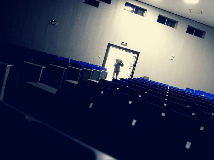 Blackandwhite Alone Architecture Architecture Architecture_collection Auditorium Blue Building Buildings Built Structure Class Classroom Indoors  Lecture Hall Lecture Room Life Lifestyle Lifestyles Light And Shadow Memories Person Seat Seats Stadium Waiting