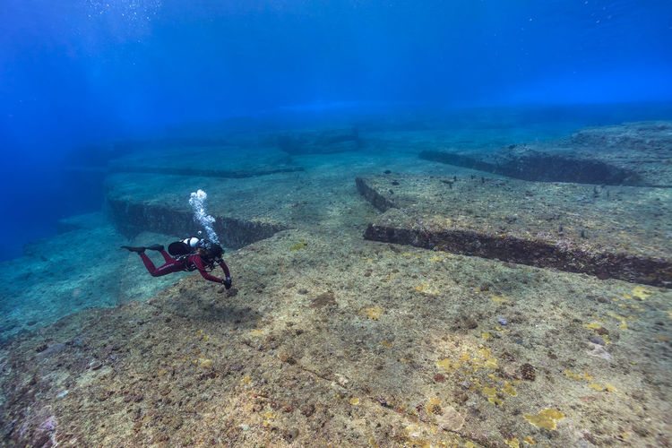 Person scuba diving at yonaguni island