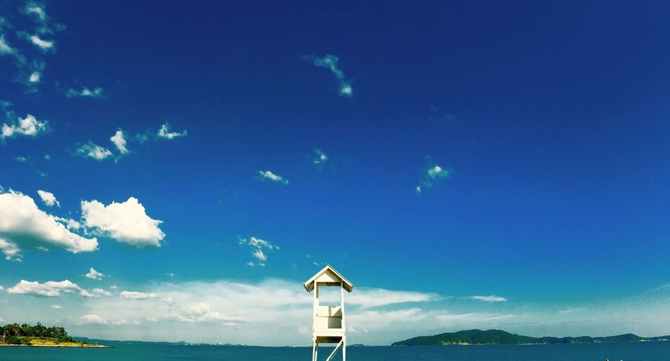 Blue Sky No People Sea Nature Day Outdoors Beauty In Nature Tranquility Tranquil Scene Cloud - Sky Scenics Water Lifeguard Hut Horizon Over Water Beauty In Nature Built Structure