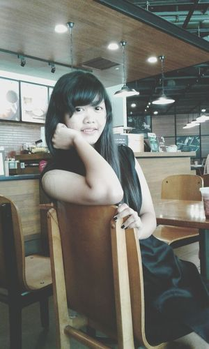 Bangs Only Women Indoors  One Woman Only Business Finance And Industry One Person Adults Only Young Adult Sitting One Young Woman Only Adult People Day Starbuckssingapore Indonesian Girl