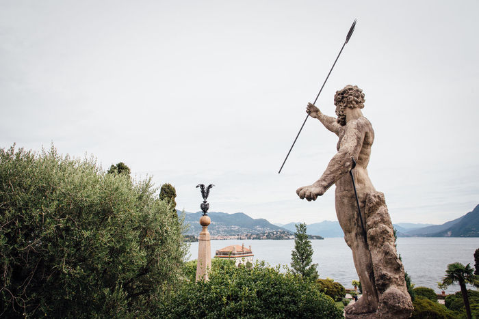 Antique God Neptune Romantic Arts Culture And Entertainment Day Dolcevita  Fishing Full Length Holding Leisure Activity Mammal Men Nature Outdoors People Poseidon Real People Sculpture Sky Standing Tree Water Young Adult Beauty In Nature Clear Sky