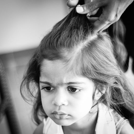 Girl having her hair maid - not looking very happy about being tied down for this whilst her brothers play around! Braids Childhood Close-up Cute Displeasure Girl Grumpy Hair Style Hairdresser Hairstyle Headshot Long Hair Miserable One Person Pretty Girl Unhappy Resist The Portraitist - 2017 EyeEm Awards Place Of Heart