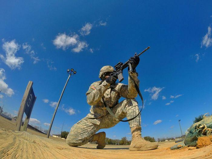 Soldier Kneeling And Shooting