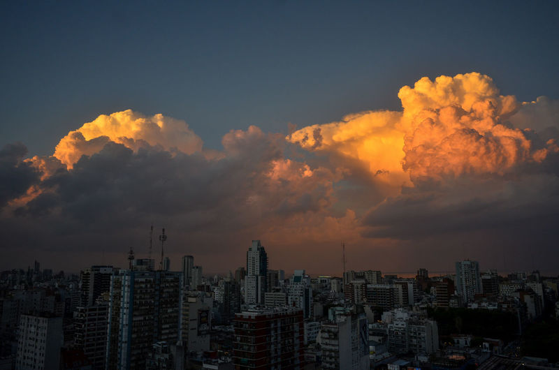Sunset with impressive clouds over buenos aires city with rio de la plata river in the back