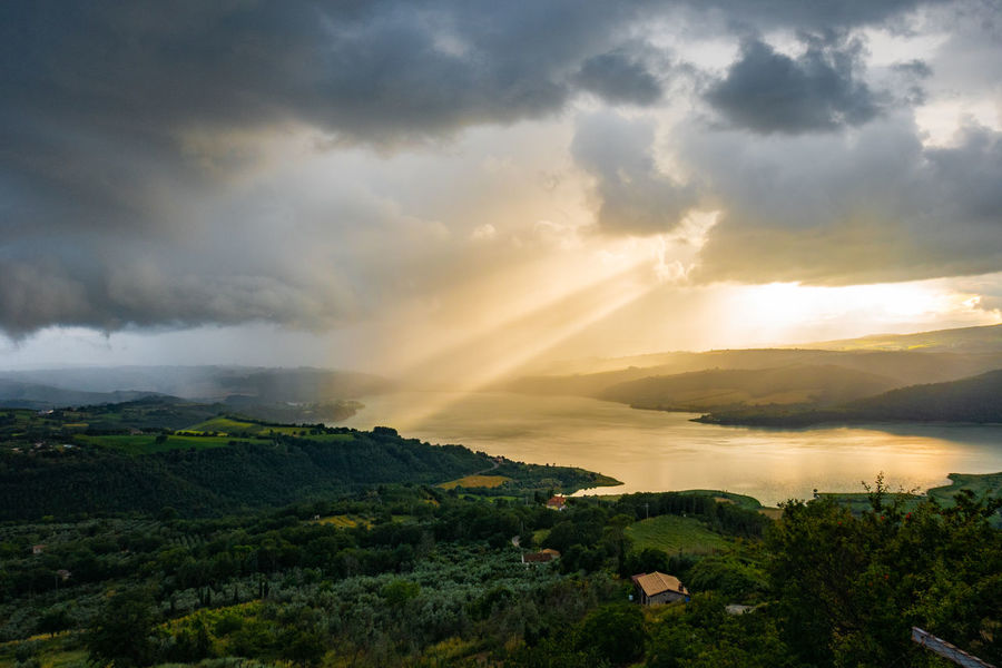 Cloudscape EyeEm Nature Lover EyeEmNewHere Landscape_Collection Rays Of Light Sunlight Sunset_collection Beauty In Nature Cloud - Sky Idyllic Italy Lago Di Corbara Landscape Nature Non-urban Scene Outdoors Scenics - Nature Sky Sunset Tourism Tranquil Scene Travel Destinations Tree Water