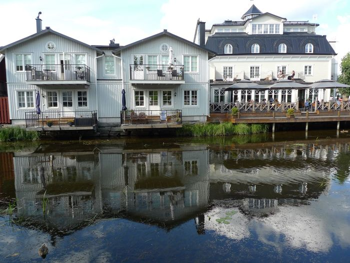 Houses along river Architecture Canal Cloud Houses Along River Front Reflection Reflections On The River Residential Building Residential Structure Sky Water Waterfront