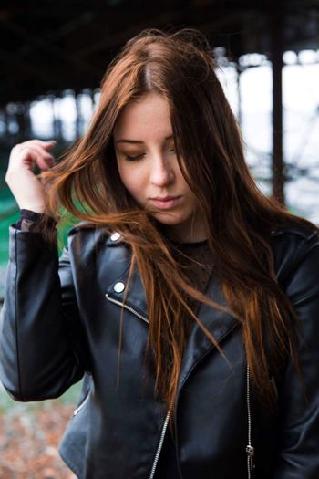 Close-Up Of Beautiful Woman Wearing Leather Jacket While Standing Outdoors