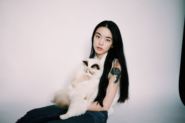 Portrait Of Young Woman Holding Cat