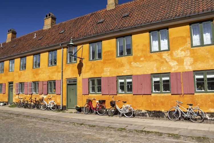 Bicycles on street against buildings in city