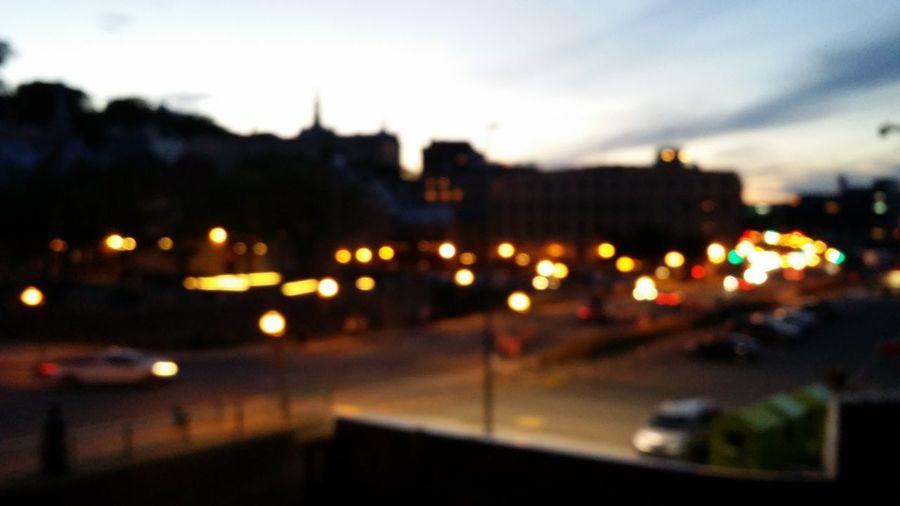 Defocused image of illuminated city at night