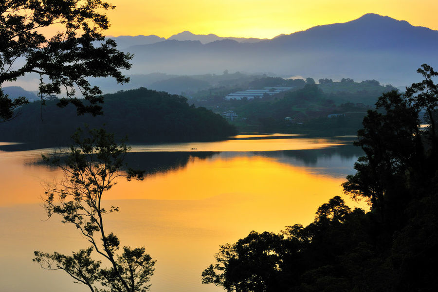 The faint color will be a romantic atmosphere Miaoli Peace Taiwan Twilight Beauty In Nature Carp Pond Dawn Day Growth Lake Mountain Mountain Range Nature No People Orange Color Outdoors Peaceful Scenics Silhouette Sky Sunset Tranquil Scene Tranquility Tree Water