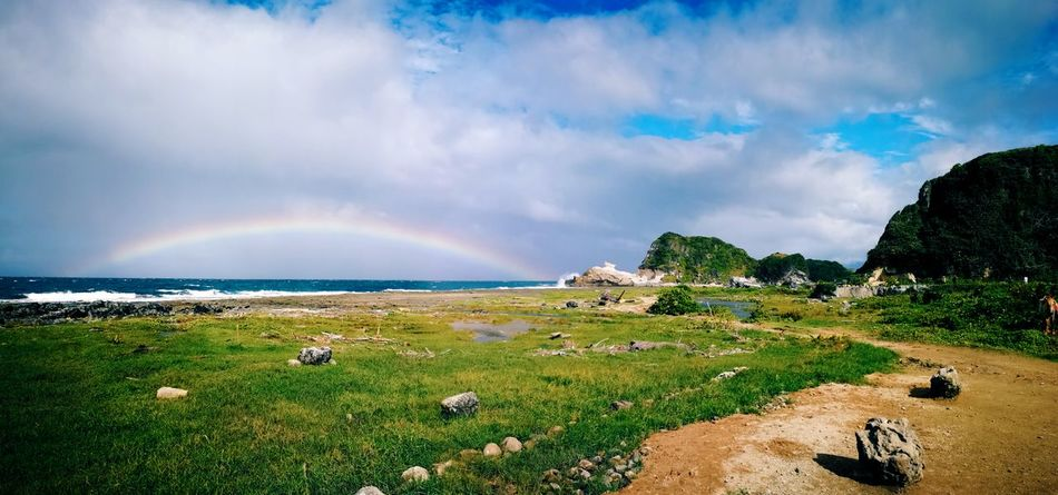 Rainbow Cloud - Sky Landscape Sea Water Beach Rural Scene Outdoors Agriculture Sky Scenics Beauty In Nature Multi Colored Nature Tranquility Mountain No People Spectrum Day Panoramic