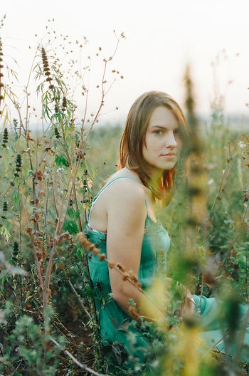 Green green grass. 35mm 35mm Film Beauty In Nature Casual Clothing Day Film Film Photography Filmisnotdead Girl Grass Ishootfilm Kodak Kodak Ultramax Leisure Activity Lifestyles Nature Outdoors Person Plant Portrait Portrait Of A Friend Portrait Of A Woman Portraits Tranquility Vintage