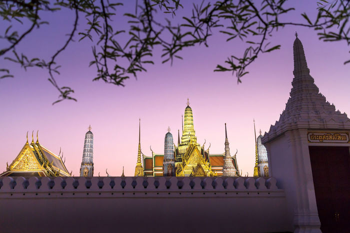 Wat Phra Kaew, Temple of Emerald Buddha at twilight Emerald Buddha Emerald Buddha Temple Entrance Gate Golden Twilight Wall Wat Phra Kaew Architecture Belief Budism Building Built Structure City Destination Place Of Worship Purple Religion Sky Spirituality Sunset Temple Tower Travel Tree