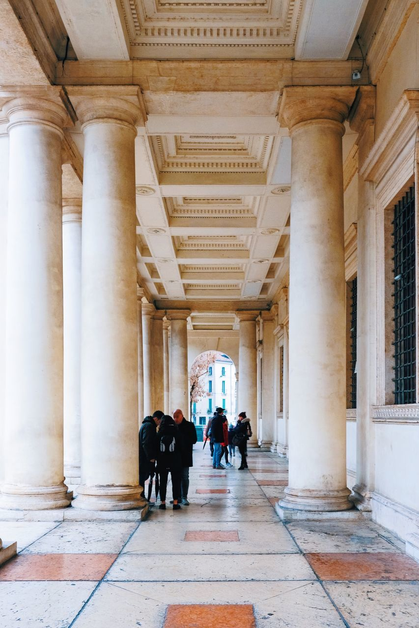real people, architecture, walking, architectural column, indoors, men, built structure, corridor, lifestyles, women, day, people