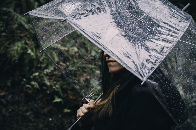 Holding Umbrella Nature Wet Rain Water Outdoors Adult Rainy Season Plant One Person Focus On Foreground Lifestyles Clear Umbrella Rainy Days Mist Hidden Beauty Obscured Face Peeking Forest Woods Hiking Adventure Pacific Northwest  Washington State Exploring Fun