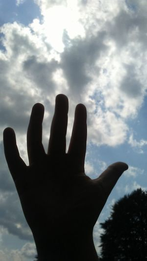 Human Body Part Cloud - Sky Human Hand Silhouette People One Person Close-up Sky Outdoors Day Reaching For The Sun Beauty In Nature This Is Family