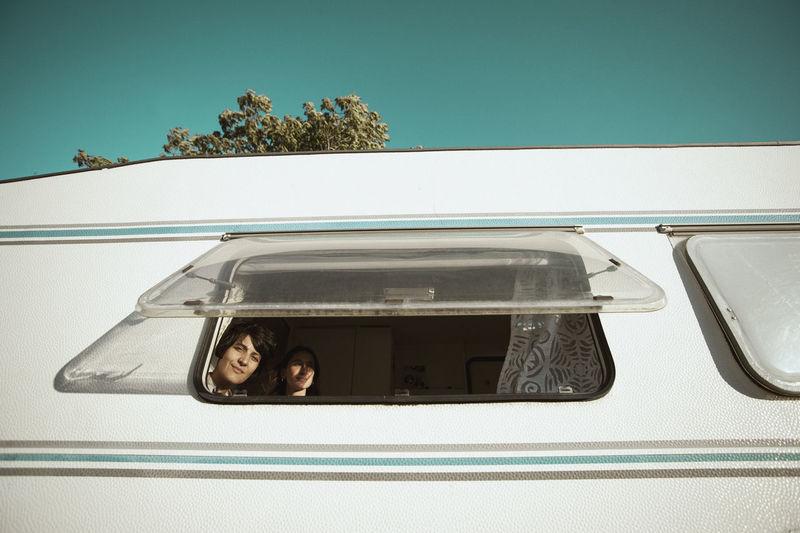 Portrait of woman by car window
