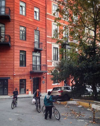 Bicycle Architecture Building Exterior Built Structure Outdoors Cycling Men Real People Day Transportation Full Length Tree City Adult People Nature Sky Only Men
