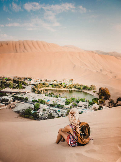 Found my oasis Nature Photography Peru Tourist Travel Traveling Backpack Beauty In Nature Climate Day Desert Environment Land Landscape Leisure Activity Nature One Person Outdoors Real People Sand Scenics - Nature Sitting Sky Tourism Travel Destinations Women Be Brave
