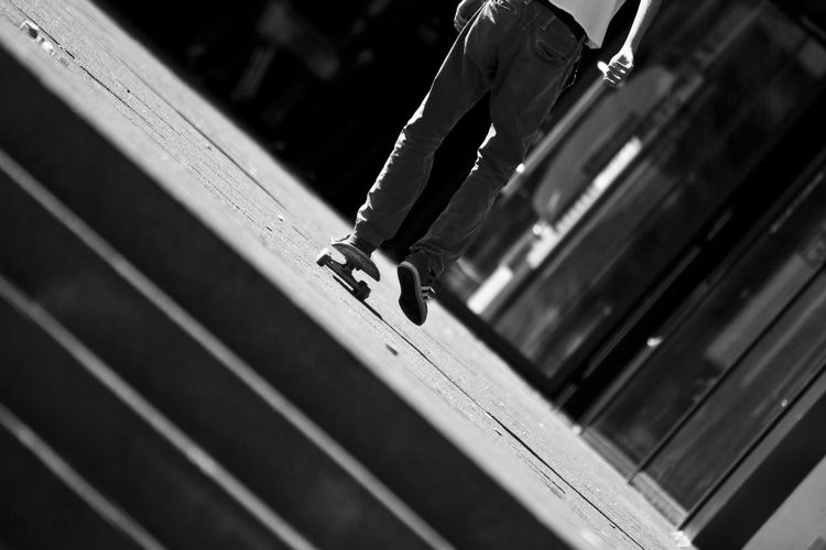 Low Section Of Man Skateboarding At Park