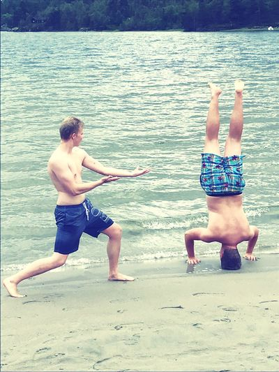Acrobatics at the beach of Norway Two People Shirtless Sea Day Beach Men Nature Water Young Adult Muscle Acrobatics  Ocean Norway First Eyeem Photo