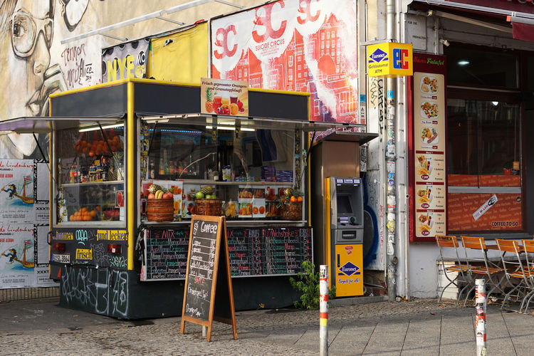 small business Warschauer Str. Berlin Communication Building Exterior Text City Built Structure Street Sign Day Script Outdoors Graffiti Advertisement No People Footpath Store Retail  Kiosk Small Business Food And Drink Berlin
