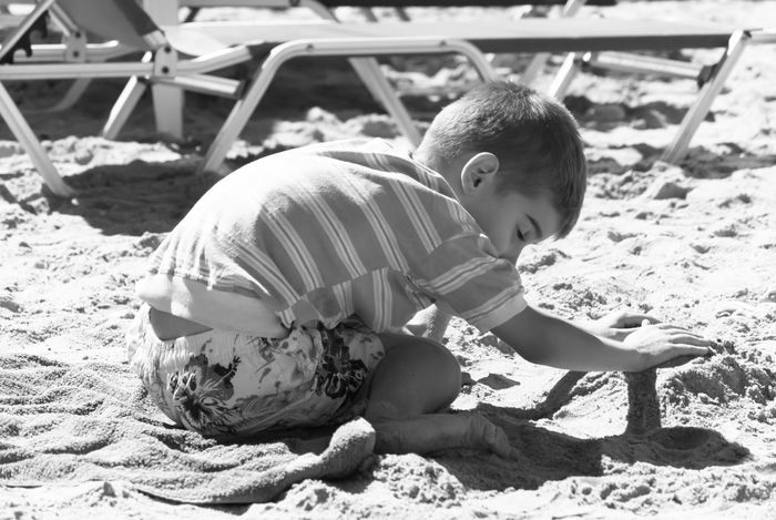 Baby Beach Boys Childhood Day Full Length One Person Outdoors People Playing Real People Sand Sand Pail And Shovel Sitting Sunlight