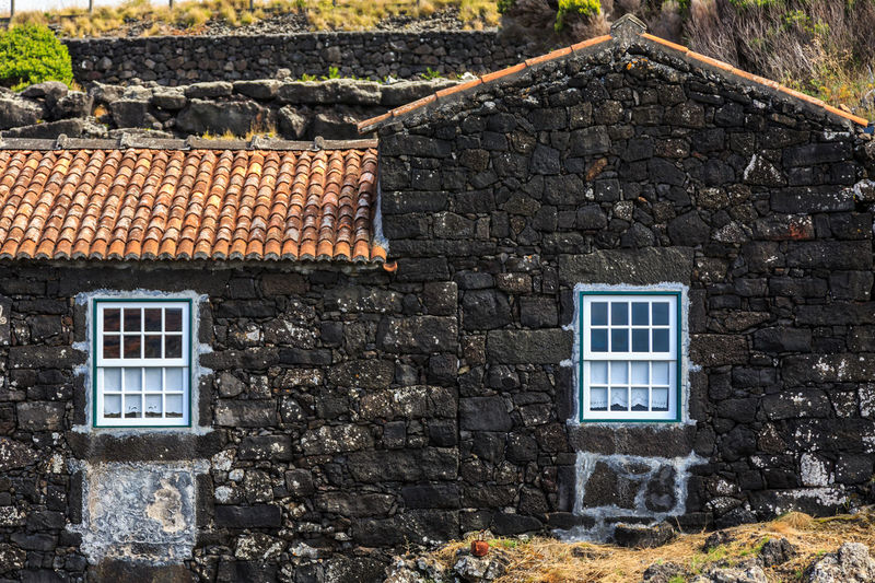 Azores Pico Island Architecture Basaltic Rock Building Building Exterior Built Structure Day History House Nature No People Old Outdoors Residential District Roof Roof Tile Row House Solid Stone Material Stone Wall Tipical House Wall Wall - Building Feature Window