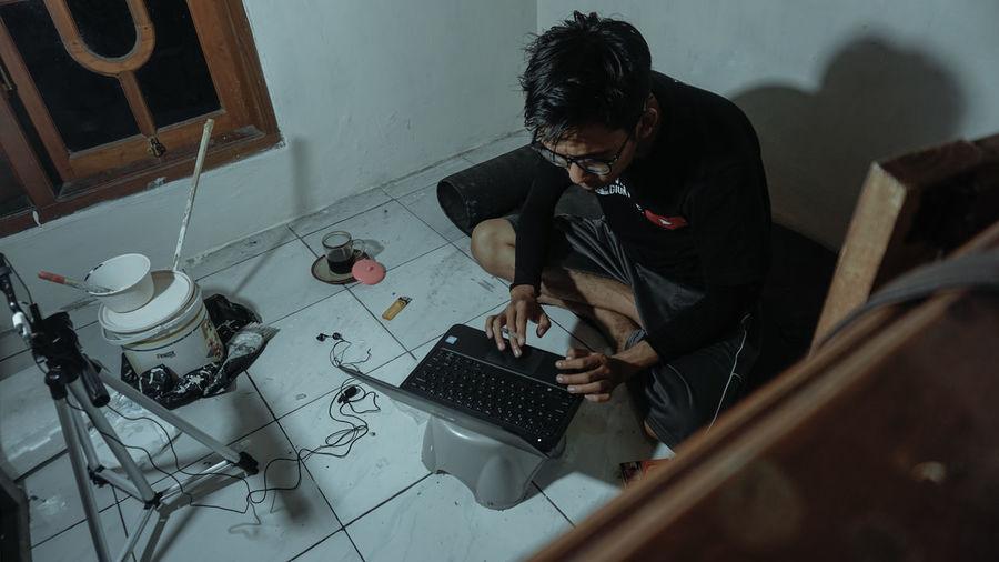 High angle view of man using mobile phone