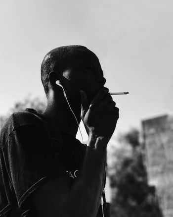 Smoking Issues Real People Leisure Activity Lifestyles Holding Focus On Foreground Smoking - Activity Bad Habit Outdoors Addiction Young Adult Clear Sky Young Women Day Sky Close-up מיישחורלבן EyeEm Selects Shotoniphone7plus מייאייפון7 IPhone7Plus The Week On EyeEm Black And White Friday
