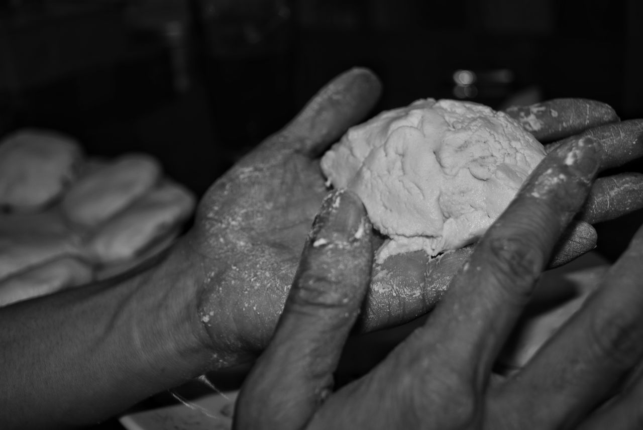 human hand, hand, human body part, real people, indoors, food and drink, people, food, holding, finger, human finger, close-up, freshness, selective focus, body part, unrecognizable person, focus on foreground, preparation, dough, care