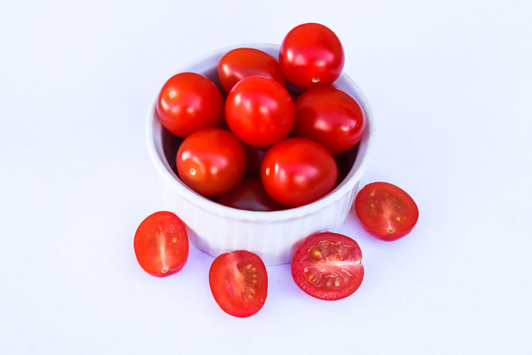 High angle view of cherry tomatoes over white background