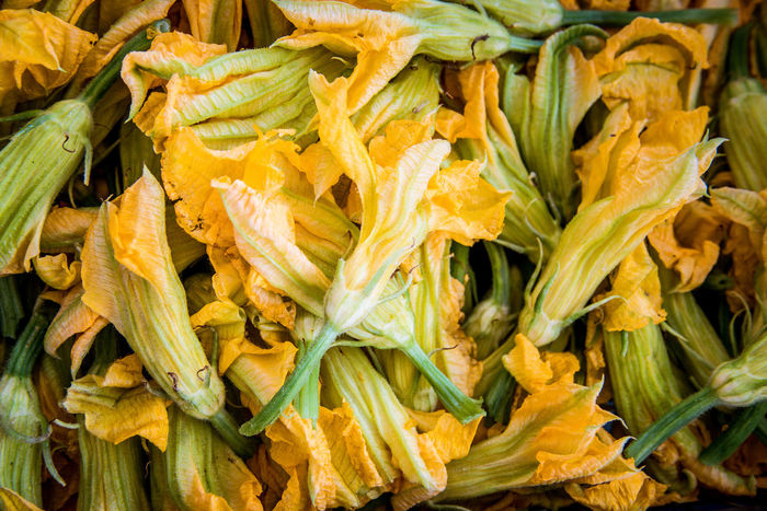 Zucchini flowers Courgette Flower Mediterranean Food Backgrounds Day Food Food And Drink For Sale Freshness Full Frame Healthy Eating Market Market Stall Raw Food Retail  Vegetable Yellow Zucchini Flower