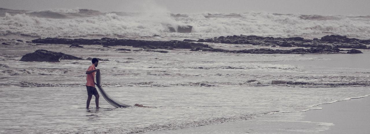 Fishing Hard Salt - Mineral Full Length Water Adventure Beach Standing Men Sky Landscape Salt Basin Salt Flat Salt Lake Surfboard Shore Sandy Beach Wave Surfing Paddleboarding Surfer Coast Arid Climate Water Sport Rushing