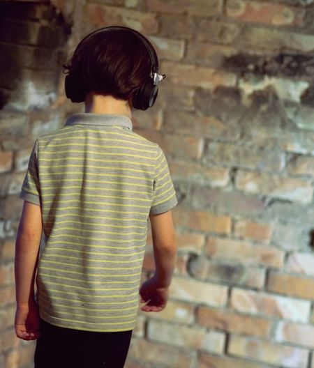 Music Listening To Music Earphones Kid From Behind Human Back Rear View Casual Clothing Brick Wall Brick