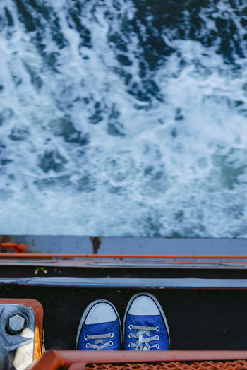 Directly above shot of shoes on boat in sea